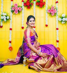 South Indian bride. Gold Indian bridal jewelry.Temple jewelry. Jhumkis. Purple and pink silk kanchipuram sari.Braid with fresh jasmine flowers. Tamil bride. Telugu bride. Kannada bride. Hindu bride. Malayalee bride.Kerala bride.South Indian wedding.