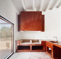 Whitewashed stone and glazed tiles feature in renovated Spanish farmhouse by Arquitectura-G
