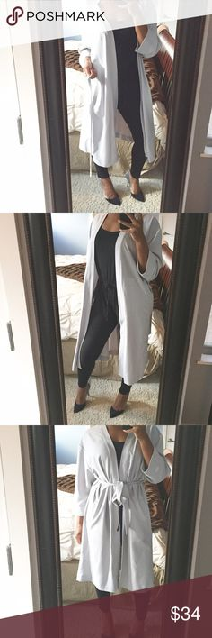 Grey Duster Jacket!! Super cute duster jacket featuring functioning side pockets, belt tie, and storm flap on back!! So chic!! I had the bright idea that this would look better over sized but it's just way too big for me lol! Great condition! Topshop Jackets & Coats