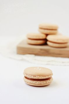 Chocolate macarons with salted caramel cream filled. Look so nice, so ...