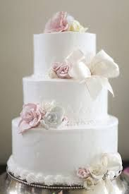 round wedding cake with pink flowers -
