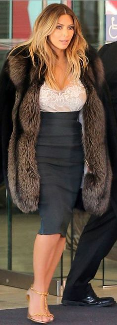 Who made  Kim Kardashian's nude lace top, black skirt, and gold sandals?