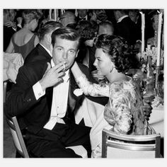 Natalie Wood, pictured here flirting with Robert Wagner at the 1959 Oscars. by Frank Worth