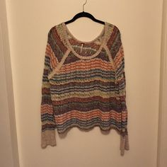 FREE PEOPLE sweater FREE PEOPLE sweater! Loose knit, striped, darling sweater! Only been worn once! Free People Sweaters Crew & Scoop Necks