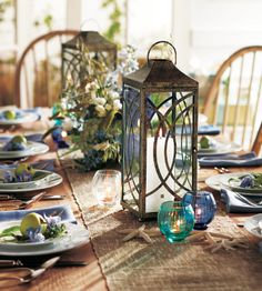 vintage feel and using fresh flowers and candles at the base of the bird cage is so elegant