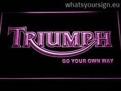 Triumph Go Your Own Way - LED neon light sign display made of the best-quality clear plastic and intense colorful LED glow. The neon sign displays exactly the same from all angles thanks to the carving with the newest 3D laser engraving process. This LED neon sign is a great gift idea! The neon is provided with a metal chain for displaying. Available in 3 sizes in following colours: White, Yellow, Blue, Orange, Red, Green and Purple!