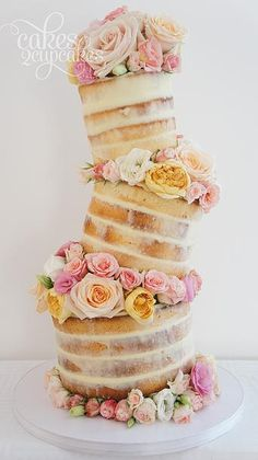 Topsy turvy naked cake surrounded by precious blooms