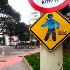 Brazilian Campaign Yarn Bombs Traffic Signs to Remind People to Donate Clothes | Mental Floss