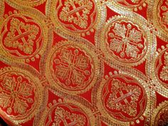 Stunning gold damask on red silk