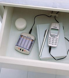 Genius! Turn one of your drawers into a charging drawer.