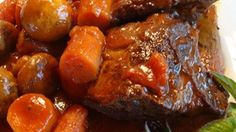 Beef short ribs are slowly braised with Bloody Mary mix and red wine in this savory dish.