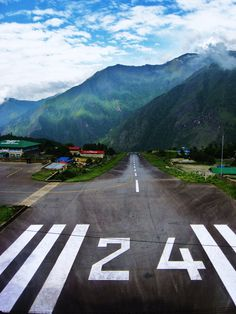 Lukla, Nepal.  I flew in and out of here. World most extreme airport.