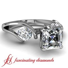 Three Stone Diamond Engagement Ring In Tension Setting