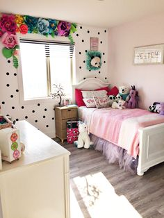 Peyton's new room- a birthday surprise!!! I made all the paper flowers by hand and painted the polkadots- her love is pandas!