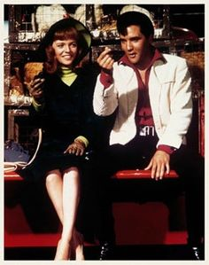 Elvis Presley and leading lady Annette Day in a scene from Double Trouble.