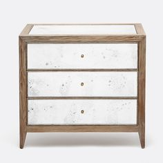 A reflection of your incredible taste, this mirrored double nightstand features three handy drawers, a dark-stained oak frame, and coppery metal drawer-pulls. The hand-antiqued mirrors give it a soft look and subtle variations from piece to piece. •Natural oak frame •Hand-antiqued mirror panels
