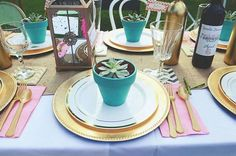 Gold bridal shower tablescape with turquoise flower pots filled with succulents at each place setting and lantern centerpieces.