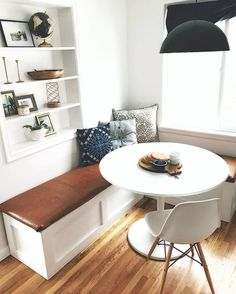 Isn't it just gorgeous how the L-shaped bench is used with the Tulip Table? http://www.manhattanhomedesign.com/tulip-table.html #interiordesign #midcentury #homedecor #tuliptable #diningtable #coffeebenches