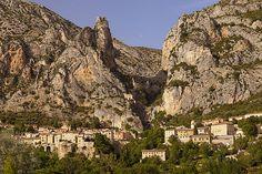 Setting sunlight over Moustier-Sainte-Marie, near Gorges du Verdon, Provence France. Photograph by Brian Jannsen