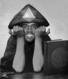 Illuminati' Kanye Doing an exact replica pose of the late Alister Crowley, the founder of the church of Satan.