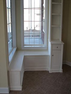 White painted built in bench seat and bookcase