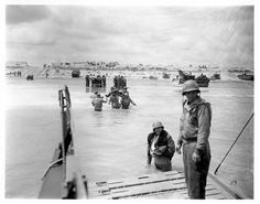 During WWII, Morris Engel enlisted in the navy and became a photographer in Combat Unit #8 under Capt. Edward Steichen. He landed in Normandy on D-Day. Here is troops landing on Utah Beach.