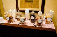 cookie table wedding favors in jars. Space saver and looks pretty!