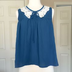 Boutique Lace Collar Blouse So cute with shorts and gladiator sandals! Lightweight with a feminine lace collar. Size M but can work for a small (shown on size small mannequin) Blue S Tops