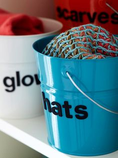 Near your busiest entryway, round up a collection of buckets to store small items.
