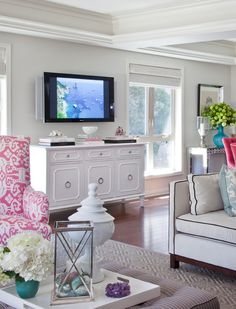 Vibrant pops of color and different patterns create detail on otherwise crisp white walls and coiffered ceilings