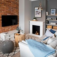 Grey wall with white furniture and wooden accessories Living Etc, Home And Living, Dream Apartment, Apartment Interior, Brick Interior, Cozy Living Rooms, Design Case, Image House, Home Hacks