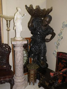 Blackamoor and pedestal with statue.  Sold