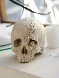 Bejeweled Skull....what a center piece at for your Halloween party. Decorate your skulls with adhesive rhinestones.