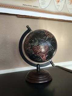 This gorgeous 8 1/2 tall black and brown globe is the most stylish way to display travel pins! Comes with plenty of pearl and rhinestone embellishments to mark all of your world travels! Display all the places youve been in an easy to see display