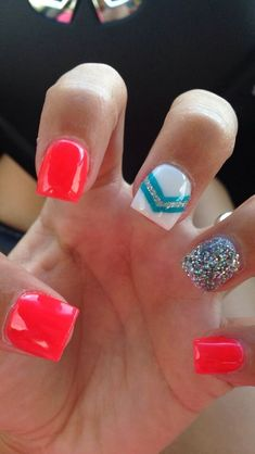 Gel and acrylic nails bright orange, white, blue and a sparkly accent