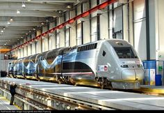"""RailPictures.Net Photo: 4402 SNCF Alstom prototype TGV POS+Duplex+AGV at Pantin, France by Jean-Marc Frybourg. Parisian high fashion (haute couture) on a race train. This is the new livery of the """"V150"""" trainset prepared for the world rail speed record. V150 stands for 150 meters per second."""