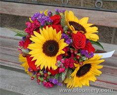 Possible bridesmaid bouquet? Kristen can get over her burning hatred for yellow for one day, because I like sunflowers.