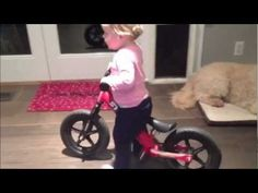 Mollys first Strider balance bike experience at 17 months.