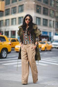 Lessons In Layering From The Streets Of New York City #refinery29  http://www.refinery29.com/2016/02/103173/ny-fashion-week-fall-winter-2016-street-style-pictures#slide-31  Khakis. Are. Back. (We called this one!)...