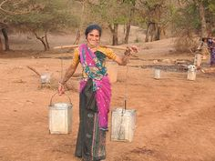 In the Gir Forest, a woman from the Maldhari tribe is carrying water.The Maldhari tribal people live among the lions in the Gir forest. They are cattle-herders almost exclusively. They are also strict vegetarians. They will occasionally lose a cattle to the lions but refuse to take revenge or compensation from the government. The Gir Forest National Park and Wildlife Sanctuary is a forest and wildlife sanctuary in Gujarat, India. Maldhari, via Flickr.