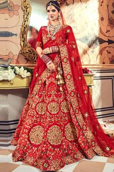 Red satin semi stictch lehenga with satin choli. This lehenga choli is embellished with resham, zari, stone, hand, zardosi and embroidered.Product are available in 32 to 58 sizes. It is perfect for Bridal Wear, Wedding Wear, Bridesmaid Wear, Guest of Wedding Wear, Mother of the Bride. #lehengacholi #usa #Indianwear #Indiandresses #andaazfashion Indian Wedding Lehenga, Bridal Lehenga Choli, Indian Weddings, Lehenga Choli Online, Silk Lehenga, Beautiful Costumes, Lehenga Designs, Red Satin, Bridal Outfits
