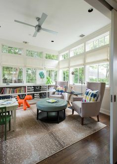 Big windows let light pour into the sunroom, which is primarily used as a playroom for the Reeds' 7-year-old triplets. The couple added this room to the first floor, which allowed them to expand the master bedroom above it. Photo: Michael Hunter