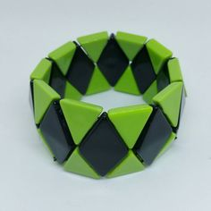 Great pop of color inn this lime green and black stretch bracelet! The pieces…
