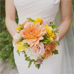 orange wedding bouqet with yellow accents  http://www.weddingchicks.com/2014/03/12/santa-barbara-yellow-and-gray-wedding/