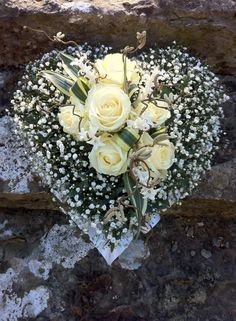 Raindrops and Roses. Beautiful heart with baby's breath and ivory roses would make a gorgeous bridal bouquet Raindrops and Roses. Beautiful heart with baby's breath and ivory roses would make a gorgeous bridal bouquet Deco Floral, Arte Floral, Grave Decorations, Flower Decorations, Funeral Floral Arrangements, Flower Arrangements, Funeral Flowers, Wedding Flowers, Funeral Sprays