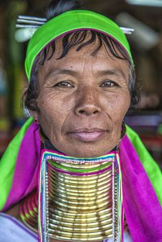 22 Long necked Padaung tribe woman wearing neck rings on Inle Lake, Myanmar. They come down from the mountains to sell their handmade jewelry and woven bags to tourists. (© Cynthia MacDonald/National Geographic Traveler Photo Contest) #