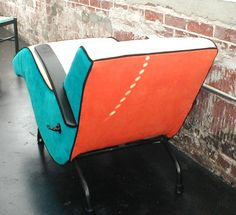 A 1950's shampoo chair I finished in colorful ultra suede.  The side you cannot see is purple.  Fun!