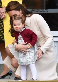 Cheerio! Little Princess Charlotte was seen smiling and waving at the crowds, no doubt pleased to see her parents after their busy day