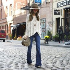 White lace top + flare jeans, fur purse spring look