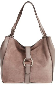Modern design meets retro-chic style in the slouchy silhouette of this spacious leather tote by Michael Kors.